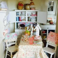 This wonderful table and table setting would look great by itself on a shelf in the kitchen. Perfectly set for little guests. 1:12 scale