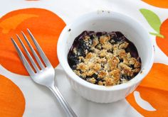 Low Carb Blueberry Cobbler - Foodie Fiasco | This is an individual serve and you can make most of it in the microwave but would need to brown the crumbles in a regular or toaster oven. I would sub erythritol (Swerve or Truvia) for the xylitol.