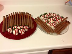 Baseball themes party! White almond bark covered strawberries with red mini m's, pretzel rods with milk chocolate almond bark and brown pretzel m's on the end.