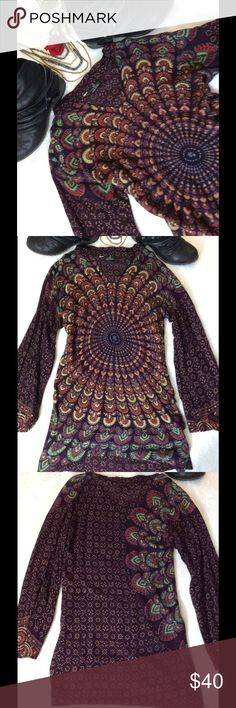 Floating Lotus Purple Psychedelic Swirled Tunic Floating Lotus Size S Circular design  Purple Orange Red Green Blue Tan  Long sleeve flared bottom Small v-neck Rounded collar  100% Rayon  Slight Hi-low 29in Shoulder top to hem front  32in Shoulder top to hem back 22in Sleeve 17in Armpit to Armpit ( no stretch) Floating Lotus Tops Tunics