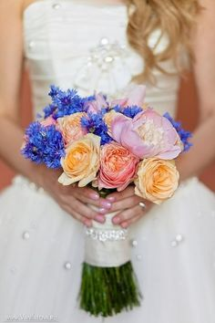 Bridal bouquet with english garden roses peonies and cornflowers