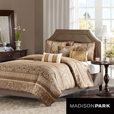 This soft coverlet set adds comfort to your bed. The set includes a coverlet, two shams, and three decorative pillows. All items are made of polyester and are completely machine washable. The brown and gold color scheme makes the bed look relaxing.