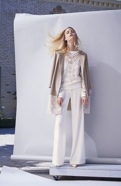 Pastels, lace and radiant white gives a cool balance of femininity and modern edge. The coat has a wide lace border; shown with an embroidered lace pullover & pants.