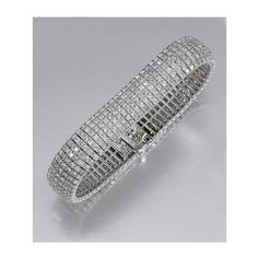 DIAMOND BRACELET  Designed as an articulated band of brilliant-cut diamonds, length approximately 180mm.