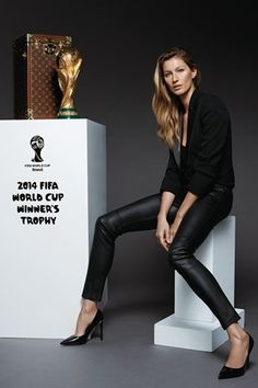 Gisele Bündchen with the FIFA World Cup Trophy and its custom-made Louis Vuitton trunk [Photo by Kevin O'Brien]