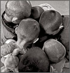the gang!  the boy on the left is wearing a string on his neck -- it is a common practice. on this string there was a house key, so that children could return home after school when their parents were still at work. also, notice the cute plush toy on his back. mischievous indeed! photo by Vladimir Rolov.