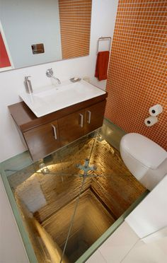 Glass Floor Bathroom    Scary bathroom with terrifying floor made of glass was constructed on top of illuminated elevator shaft of the 15-story building in Guadalajara, Mexico. Creative bathroom was designed by Hernandez Silva architects for the owners and guests of the penthouse apartment. Scared people can sit on the toilet and look through transparent floor.