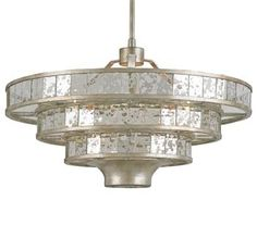 Glass panels line the elliptical tiers of this stylish layered fixture that calls on vintage glamour for inspiration. Tapering downward, the Frappé Chandelier's Silver Granello finish brilliantly complements the antiqued glimmer of Raj Mirror. Round Chandelier, Silver Chandelier, Vintage Chandelier, Modern Chandelier, Chandelier Lighting, Kitchen Chandelier, Kitchen Lighting, Antique Glass, Antique Silver