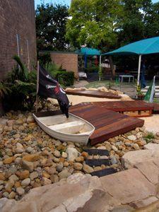 kid friendly yards | boat in dry creek bed at John Brotchie Preschool