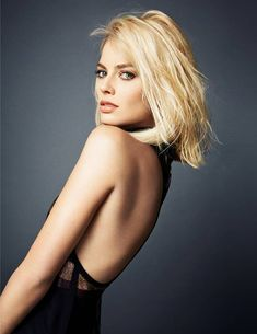 Margot Robbie leanin for success..