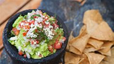 Ready, set, dip into this TODAY Food staff-favorite guacamole that's topped with delicious pico de gallo.