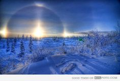 """Sun halo, called Sun Dog - Beautiful winter scenery with country under snow and a sun with halo circle around, called """"Sun Dog."""""""