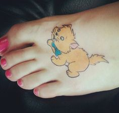 Toulouse from Aristocats on my left foot. Done by Todd Johnson of Buzz n' Bones tattoo in Everett, Wa.    Aristocats was always my favorite movie as a child and Toulouse was my favorite character. He reminds me to keep an air of creativity and playfulness in all situations; no matter where life takes me.