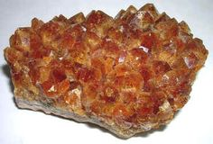 Citrine.  Citrine is the crystal of positivity, abundance and prosperity.  I wear citrine as my business power stone and keep it in my office.  Just as it brings good things to you, it helps you do good for others, inspiring generosity and creativity.    You can use it for motivation to stop slacking and give of yourself, too!  This is such a joyful stone, and a great addition to your workplace.