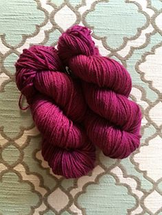 Pokeberry dyed yarn. Link goes to Ravelry page with notes on method used, which included keeping the berries in a pair of pantyhose to keep seeds from getting all through the yarn.