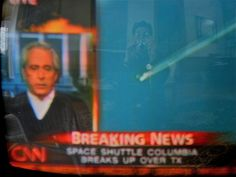 This is a photo of the TV screen, taken on February 1, 2003, minutes after the space shuttle Columbia breaks up over Texas. ∞ Note my reflection on the right side.     Hours after the Turkish government surprised the protesters, and sent security forces to evict them from ceremonies, where tonight thousands place. The police used water cannons and tear gas, and reportedly the country, some of the wounded were evacu