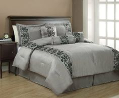 "11PCs King Penelope Black and Gray Bed in a Bag Set by KingLinen. $114.99. This luxury comforter set features scroll motif flocking on gray faux silkground . Great for any bedroom.  3 decorative pillows included.FeaturesSize: KingColor: Black/Gray100% PolyesterMachine washableThis set includes:1  Comforter (101""x86"")2  Shams (20""x36"")1  Bedskirt(78""x80""+14"")3  Decorative Cushions Plus 300 Thread Count Cotton Sheets:2 King pillowcases (20"" x 40"")1 King flat..."