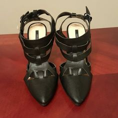 NWT Black Strappy Faux Leather Heels These are nwt heels in a size 6. They are true to size. There are a few small imperfections in 3rd/4th photos.  There is a tiny grey line on the left shoe near the point that you honestly cannot see unless the shoe is in your face. All imperfections are unnoticeable when worn. Forever 21 Shoes Heels