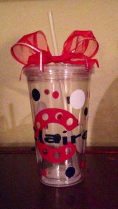 Cheer cups made with cricut vinyl, ribbon and dollar store cups.