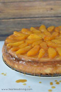 Vanilla Bean Infused Cheesecake with Dark Rum Peaches   http://www.fearlessdining.com  #cheesecake #glutenfreecheesecake