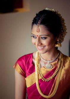 South Indian bride. Gold Indian bridal jewelry.Temple jewelry. Jhumkis.Red silk kanchipuram sari.Braid with fresh flowers. Tamil bride. Telugu bride. Kannada bride. Hindu bride. Malayalee bride.Kerala bride.South Indian wedding.
