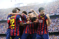 Neymar (C) of FC Barcelona celebrates with his team-mates after scoring the opening goal during the La Liga match between FC Barcelona and Real Madrid CF at Camp Nou on October 26, 2013 in Barcelona, Catalonia.