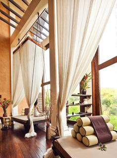 Perfect relaxing spot idea! Curtains and Thai cushions decor at our spa. Anantara Golden Triangle Resort & Spa, Chiang Rai, Thailand