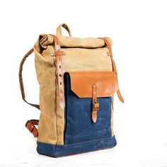 Roll top waxed canvas backpack. in navy blue and yellow.