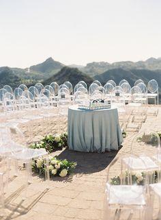 A circular wedding ceremony: http://www.stylemepretty.com/california-weddings/malibu/2016/02/26/elegant-malibu-rocky-oaks-wedding-in-shades-of-blue/   Photography: Caroline Tran -  http://carolinetran.net/