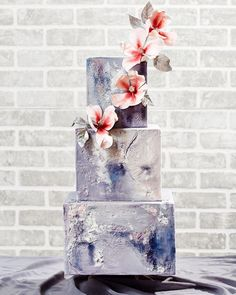 To match your modern theme, add a three-tiered, textured cake topped with climbing orchids to the menu.