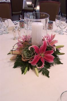 Centerpiece - hurricane lamp with lilies and succulents