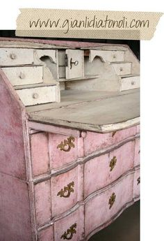 Love the aged pink patina on this secretary desk.