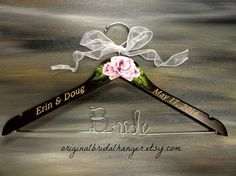 Elegant Bridal Hanger Wedding Dress Hanger by OriginalBridalHanger Wedding hangers make awesome photo props.  This hanger is engraved and also has a hand painted flower at the top.