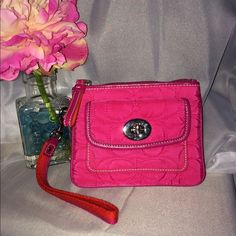 Authentic Coach Wristlet-NWOT Authentic Coach Hot Pink, Quilted Wristlet.  NWOT.  Zippered top with wrist strap.  Inside has slot for cards/ID.  Outside has turn lock closure with pocket.  Bought new on Poshmark, but a bit too small.  Otherwise, a very pretty pink and cute Wristlet.  Selling price is what I paid. Coach Bags Clutches & Wristlets