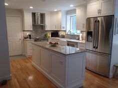 White modern kitchen, Brand new white kitchen with stainless steel appliances, granite countertops and mosaic blacksplash., Simple, white, modern kitchen!, Kitchens Design