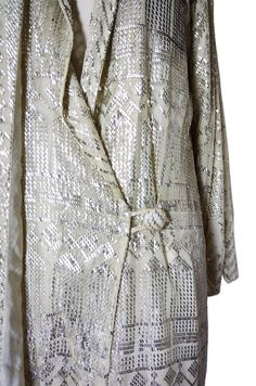 Detail from a 1920s  Assiut Flapper Coat - Love the covered button!