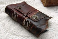 Finding the Words - Thick Leather Journal, Two Toned, Hand Embossed, Tea Stained Recycled Pages OOAK. $155.00, via Etsy.