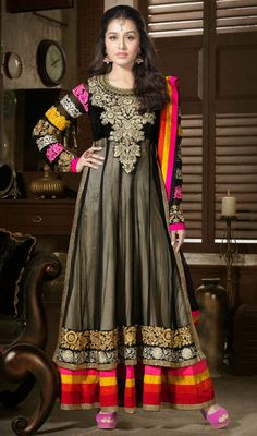 Shraddha Kapoor Net Layered Long Length Anarkali Suit Submerge yourself in pure ecstasy like Shraddha Kapoor as you step into this black shade net layered long length Anarkali suit. Embroidered floral patterned neck patch and hemline lends beauty. Multicolored panel decked hemline makes the apparel truly eye-catching. #BollywoodPakistaniSuits #AnarkaliSalwarKameez