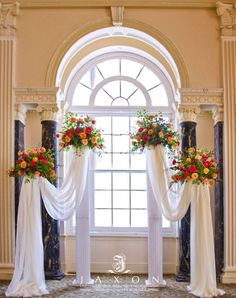 Modernizing Columns- The use of columns in ceremonies is often considered dated. GIve them a stylish twist by adding flowers and fabric, as seen in this pi