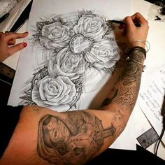 This cross with roses would be a nice tattoo