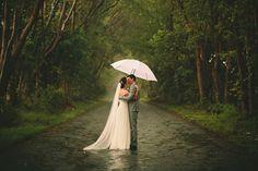 Love rainy day wedding pics....