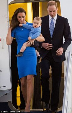 The Royals in blue: Catherine and baby George arrived in Canberra wearing matching blue outfits and even William had a blue tie
