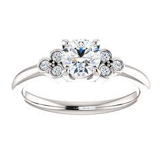 10kt White Gold 5.2mm Center Round Gnuine Diamond and 6 Accent Round Diamonds Engagement Ring...(ST71586:416:P).! Price: $1029.99