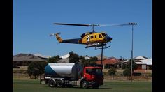 Helitac coming in for refueling on the Ellenbrook oval in fire fighting support for the bushfires in BULLSBROOK Western Australia in Jan 2015.