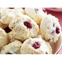 Coconut, cranberry and white chocolate macaroons recipe - By Australian Women's Weekly, Sweet, chewy coconut macaroons studded with tart dried cranberries and white chocolate chunks.