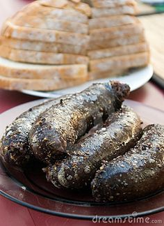 Traditional Polish blood sausage, grilled on barbecue, some bread slices in the background.  <a href='http://www.dreamstime.com/food-photos-and-table-settings-rcollection4782-resi208938' STYLE='font-size:13px; text-decoration: blink; color:#FF0000'><b>MY FOOD PHOTOS »</b></a>