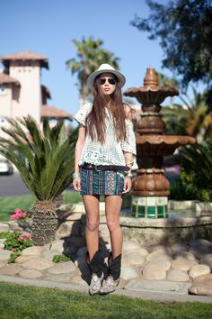 Tribal print shorts and skirts are huge this summer. Pair them with the other hot summer trend, crochet, and some vintage cowboy boots (I steal and wear my dad's).