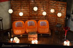 Don't like the blowup chairs but like the pallet platform, the string lights and pallet background for a youth room