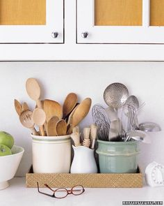 Group wooden utensils in one crock, stainless-steel ones in another. Line up crocks next to the cooktop, for easy access.