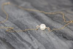 Freshwater Pearl Necklace, Round Pearl Necklace, Single Pearl Necklace, June Birthstone Jewelry, June Birthday, 14k Gold, Sterling Silver  This listing is for one, high quality pearl drop necklace strung from a sterling silver or 14k gold filled chain.  All freshwater pearls are natural and come with slight variation, but Ive hand selected the best! Pearls are round and have a beautiful glow as seen in photos.  Please choose your length and metal of choice from the drop down menu on the…